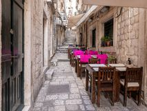 Dubrovnik, Croatia - april 2019: Old City of Dubrovnik. Outdoor restaurant in one of the narrow streets of medieval town royalty free stock images