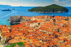 Old city of Dubrovnik panorama from the city walls,Croatia. Traditional Mediterranean houses with red tiled roofs and rocky green idyllic island in background Royalty Free Stock Photos