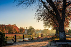 Old city embankment on early autumn morning. Embankment of the old city early in the autumn foggy morning Royalty Free Stock Photo