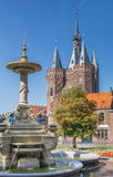 Old city gate Sassenpoort and foutain in Zwolle royalty free stock photos