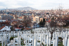 Old City Hall background & the cemetery on the hill of Sarajevo Royalty Free Stock Photo