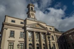 Old city hall in Dordrecht, Netherlands on a sunny afternoon. The sky is blue with clouds Royalty Free Stock Photos