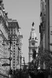 Old city hall among modern buildings Stock Photography