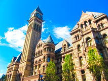 Old city hall of Toronto in gothic style under the sunset light Royalty Free Stock Images