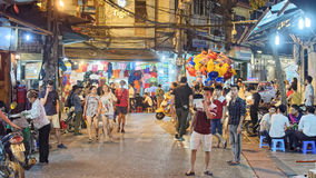 Old city of Hanoi at night. Tourists and diners at restaurants in the old city of Hanoi at night, Vietnam Royalty Free Stock Photography