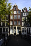 Old city houses along canal in Amsterdam, Holland Stock Photo