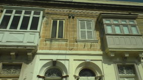 Old city houses in Malta from bus stock footage
