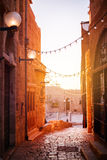 Old city Jaffa near Tel-Aviv, Israel. Sunset light on old stone narrow street, selective focus Stock Images