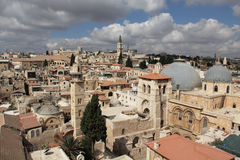 Old City of Jerusalem. Nice view of the Christian Quarter of the Old City of Jerusalem. Holy Sepulcher against the blue sky and clouds Stock Photos