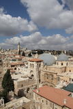 Old city of Jerusalem. Nice view of the Christian Quarter of the Old City of Jerusalem. Holy Sepulcher against the blue sky and clouds Stock Image