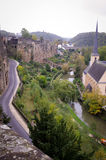 Old City Luxembourg. A view from the ramparts from the upper to the lower city of Luxembourg with the fortress walls on the left and cathedral and Alzette river royalty free stock image