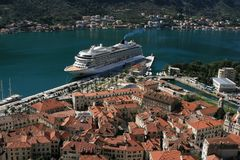 Old city and luxury passenger ship Royalty Free Stock Photography