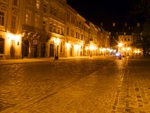 Old city by night. Central square around the town hall in old city Lviv (Ukraine) in night light Stock Image