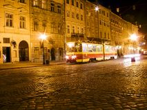 Old city by night. Tramway in central square around the town hall in old city Lviv (Ukraine) in night light Stock Photography