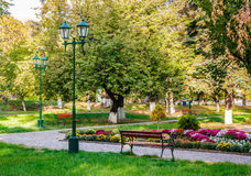 Old city park with lantern. Lantern near bench in empty city park in the morning Stock Photos