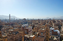 The Old City of Sana'a, decorated houses, palace, minarets and the Saleh Mosque in the fog, Yemen. The Old City of Sana'a, the oldest continuously inhabited and stock images