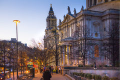 Old City street leading to st. Paul cathedral. Street view with evening lights and public house. LONDON, UK - DECEMBER 19, 2014: Old City street leading to st Royalty Free Stock Photo