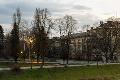 Old city street in the morning. Empty old european  city street with lanterns near the park in the morning Stock Photography