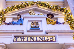 Old City Street Twinnings Tea Shop Nght London England. Old City Street Twinnings Chinese Tea Shop Nght London England. Chinese figurines to show the tea comes Stock Image