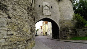 Old city in Tallinn, Estonia. Big Sea gate and tower Fat Margarita stock video footage