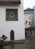 Old city, Tallinn, Estonia. Holy Spirit Church and the old clock (1684) Royalty Free Stock Image