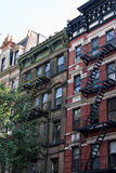 Old City Tenement Buildings. Some vintage tenement buildings with iron fire escapes Stock Photography