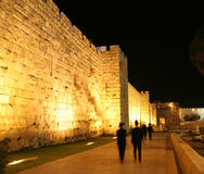 Old City Wall Jerusalem. Orthodox Jews going to the Wailing Wall for night time prayers..(Subjects blurred to generate movement royalty free stock photo