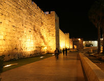 Old City Wall Jerusalem at Night. Orthodox Jews walking to the Wailing Wall for night time prayers.. Intentional Blurring of subjects royalty free stock photo