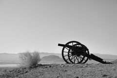 Old Civil War Cannon in the field of lookout mountain in Calico Ghost Town. Black and White photography Stock Photo