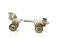 Old clamp-on roller skate on white Royalty Free Stock Images