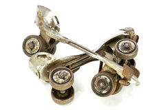 Old clamp-on roller skates on white Stock Photo
