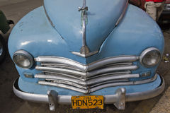 Old clasic light blue cuban car front. Front of light blue old classic cuban car. Past international embargoes have meant Cuba has maintained many pre Stock Images