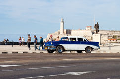Old classic american car in Havana. With El Morro castle in the background Stock Photo
