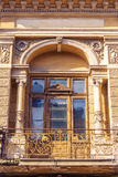 Old classic architectural balcony. View of large old classic architectural balcony with columns, arcade and metal railing Stock Photography