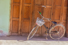 Old classic bicycle parked in front of old wood plank wall Stock Photography