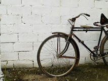 Bicycle against concrete wall Stock Image
