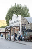 Old classic buildings and shops on Buckingham Street in the historic town of Arrowtown. Arrowtown, New Zealand - February 2016: Old classic buildings and shops Stock Image