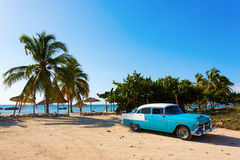 Old classic car on the beach of Cuba royalty free stock photos