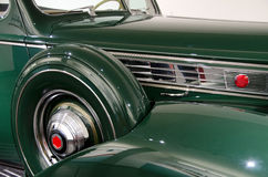 Old classic car beauty in green. Right front side of an old green classic car beauty Stock Images