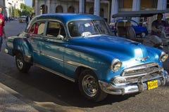 Old classic car in Cuban street, Havana. Havana, Cuba- January 2, 2011; old classic blue car in Cuban street, Havana Stock Photo