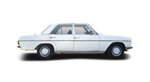 Old classic car. Isolaed on white Royalty Free Stock Photos
