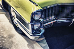 Old classic car. Stylized angle detail of an old classic car with vintage filter Stock Photo