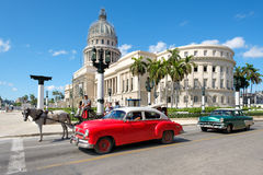 Old classic cars next to the Capitol in downtown Havana Royalty Free Stock Images