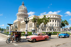 Old classic cars next to the Capitol in downtown Havana Stock Photo