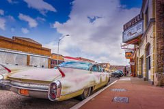 Old Classic Cars and Trucks. A beautiful and historic scene with old buildings, signs and of course some classic cars and trucks Stock Images