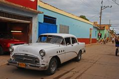Old classic Cuban car parked on a side street in Trinidad, Cuba stock images