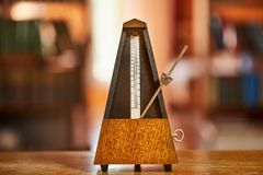 Old Classic Metronome. Classic metronome in a room with warm tone stock images