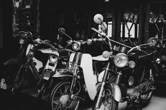 Old and Classic motorcycle parked in garage. Royalty Free Stock Images