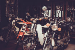 Old and Classic motorcycle parked in garage Royalty Free Stock Photography