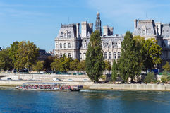 Old classic palace on bank of river Seine in Paris Stock Photos